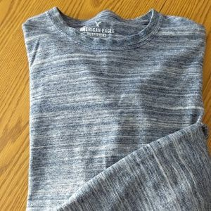 Mens/Young Mens long sleeve knit henley top. Small